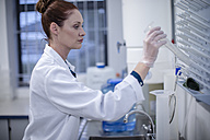 Woman working in lab - ZEF10829