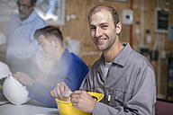 Smiling young man attending an electrician workshop - ZEF10878