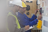 Two electricians working on electrical panel - ZEF10899
