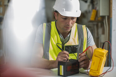 Electrician working with voltmeter - ZEF10914
