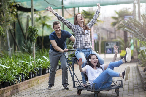 People being silly and having fun at garden centre - ZEF10992