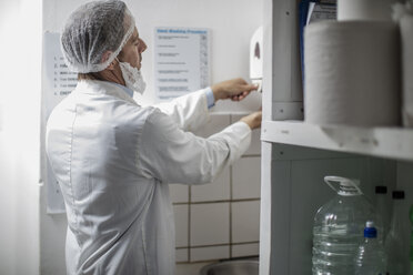 Cheese factory worker washing hands - ZEF11037