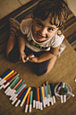Top view of smiling little girl with many felt tip pens - LOMF00427
