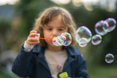 Little girl blowing soap bubbles - LOMF00430