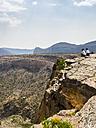 Oman, Jabal Akhdar, Two women looking at mountain view - AMF05038