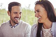 Happy couple outdoors - ZEDF00398
