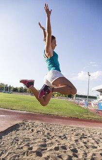 Female long jumper mid-air - ABZF01371