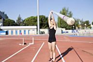 Female pole vaulter holding pole - ABZF01374