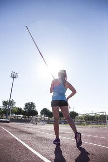 Female pole vaulter preparing - ABZF01389