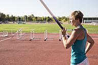 Female pole vaulter preparing - ABZF01392