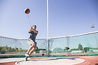 Athlete performing a hammer throw - ABZF01404