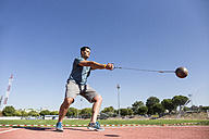 Athlete performing a hammer throw - ABZF01407