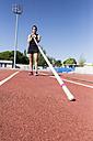 Female pole vaulter holding pole - ABZF01410