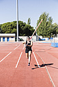 Female pole vaulter running with pole - ABZF01413