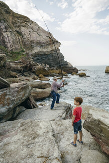 Grandfather and grandson fishing together at the sea - DAPF00414