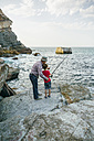 Grandfather and grandson fishing together at the sea - DAPF00432