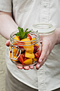 Person holding jar with fruit salad - EVGF03097