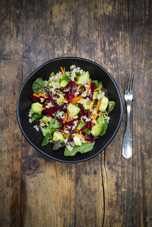 Bowl of autumnal salad with lettuce, carrots, avocado, beetroot, pumpkin and sunflower seeds, pomegranate and quinoa - LVF05488