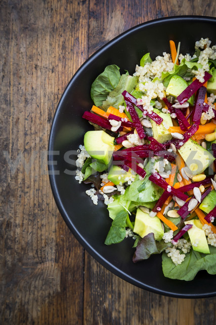 Bowl of autumnal salad with lettuce, carrots, avocado, beetroot, pumpkin and sunflower seeds, pomegranate and quinoa - LVF05491