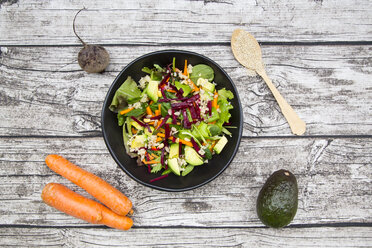 Bowl of autumnal salad with lettuce, carrots, avocado, beetroot, pumpkin and sunflower seeds, pomegranate and quinoa - LVF05494