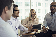 Business people in meeting having interesting discussion - WESTF21771