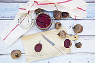 Whole and sliced beetroots and preserving jar of pickled beetroots - LVF05504