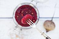 Piece of pickled beetroot skewered on fork - LVF05507