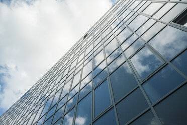 Modern glass facade reflecting clouds - TAMF00719