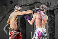 Two boxers covered with paint fighting - STSF01130