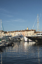 France, Saint-Tropez, marina and clock tower in background - DEGF00920