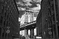 USA, New York City, part of Brooklyn Bridge between facades - ZEF11115
