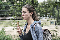 Young woman with ice cream cone - TAMF00729