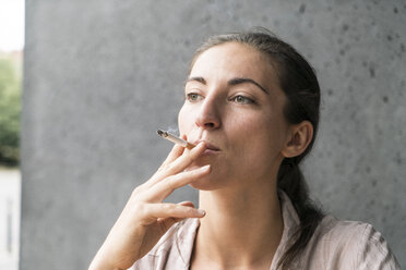 Portrait of smoking young woman - TAMF00735