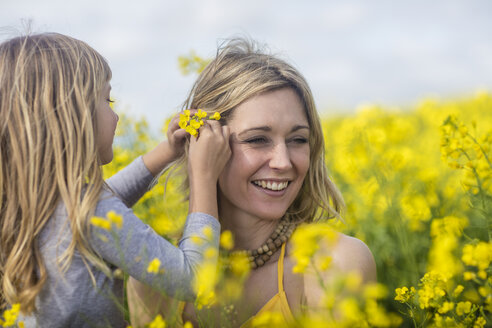Mother and little daughter together in rape field - ZEF11128