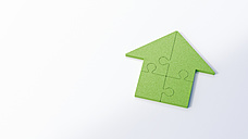 Green jigsaw house on white background - AHUF00273