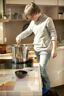 Little boy cooking in the kitchen - TSFF00137