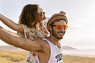 Couple having fun near the coast - MGOF02582