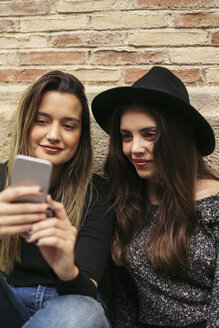 Two best friends looking at smartphone - EBSF01858