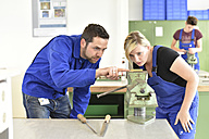 Instructor with trainee at workbench - LYF00620