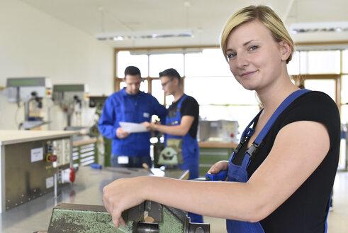 Portrait of smiling female trainee in workshop - LYF00626