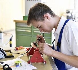 Student assembling circuit board - LYF00647