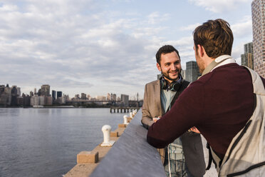 USA, New York City, two young men at East River - UUF08915