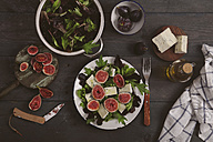 Plate of mixed lettuce with fresh figs, goat cheese and olive oil - RTBF00471