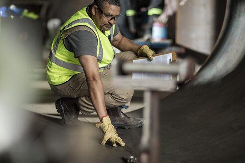Engineer examining construction parts - ZEF11206