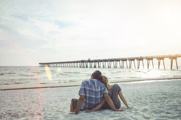 USA, Couple sitting at Panama City Beach leaning against each other - SHKF00710