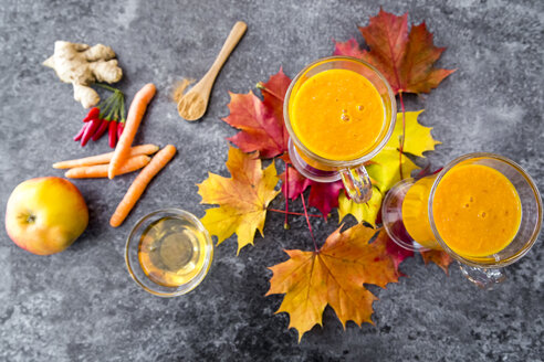 Two glasses of pumpkin smoothie and ingredients - SARF03034