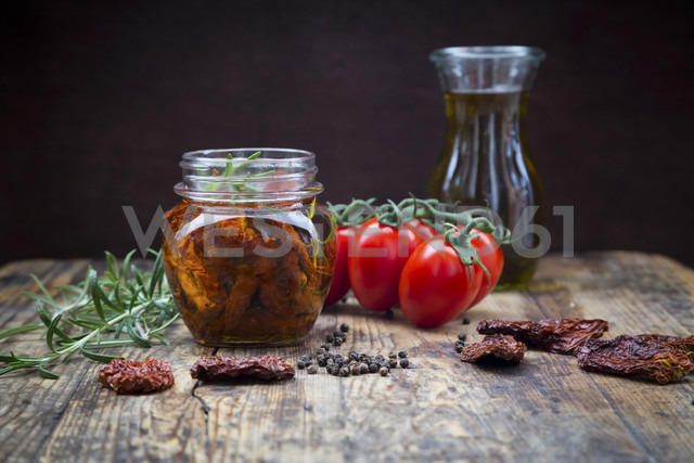 Glass of pickled dried tomatoes and ingredients - LVF05535