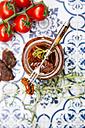 Pickled dried tomato skewered on fork - LVF05544