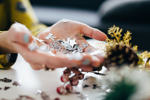 Woman's hands holding Christmas decor - LCUF00073