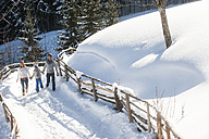 Family walking in snow - HHF05459
